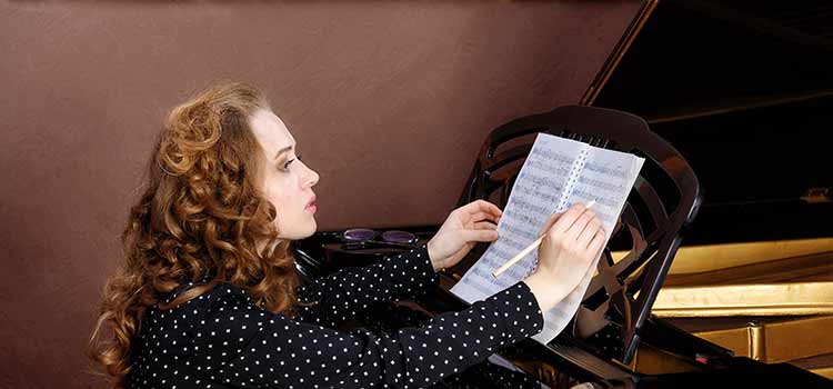 Lady looking at the piano score