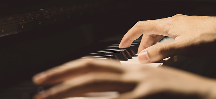 Photo of hands on the piano